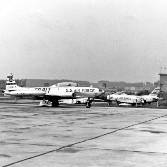 T-33 16817 of the 50th Fighter Bomber Wing and F-86H 53-1429 of the 417th Fighter Bomber Squadron. The photo was taken April 28, 1956. Both aircraft would crash in the coming weeks.