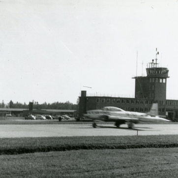 T-33A hurries past the Hahn tower.