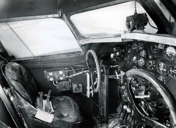 Cockpit of the 247-Y had the addition of the gun charging handles seen jutting from the instrument panel in front of the pilot's yoke.