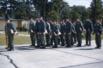 With bulging briefcases, students of the 3300th Pilot Training Group prepare to march.