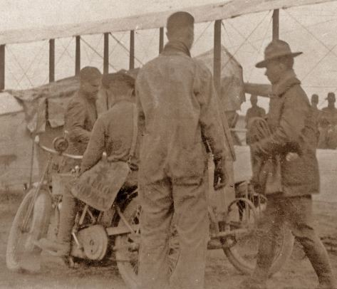 The man astride the Harley Davidson (one of six brought on the expedition) carries a dispatch bag bearing the markings of the 1st Aero Squadron.