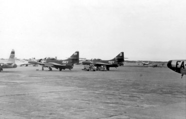 "A pair of visiting F9F-5 Panthers of VF-192. On this deployment to the Far East in 1953-4, VF-192 had a starring role in the immortal film ""The Bridges at Toko-ri"". No doubt these are two of the aircraft seen in that picture."