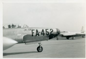 51-5452 zooms past a T-33.