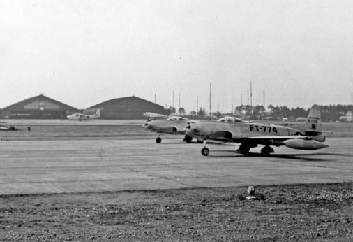 F-80s of the 41st Fighter Interceptor Squadron. 49-774 leads the way.