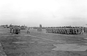 Pass in review for men of the 35th Fighter Interceptor Wing. SA-16s in the background.