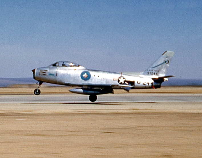 F-86A (49-1244) of George AFB's 94th Fighter Interceptor Squadron flares for landing.