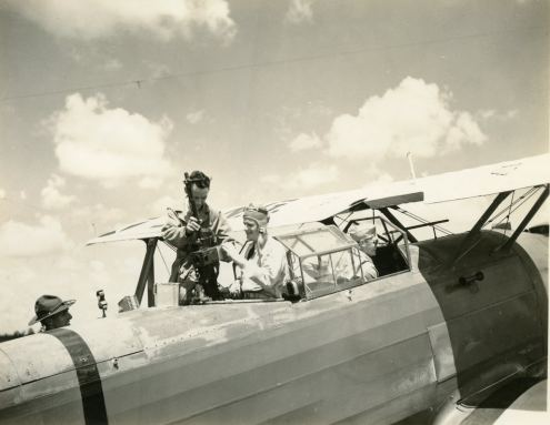 One of the squadron's pilots is preparing for some aerial gunnery himself. He will not hit a thing, but will have fun trying.