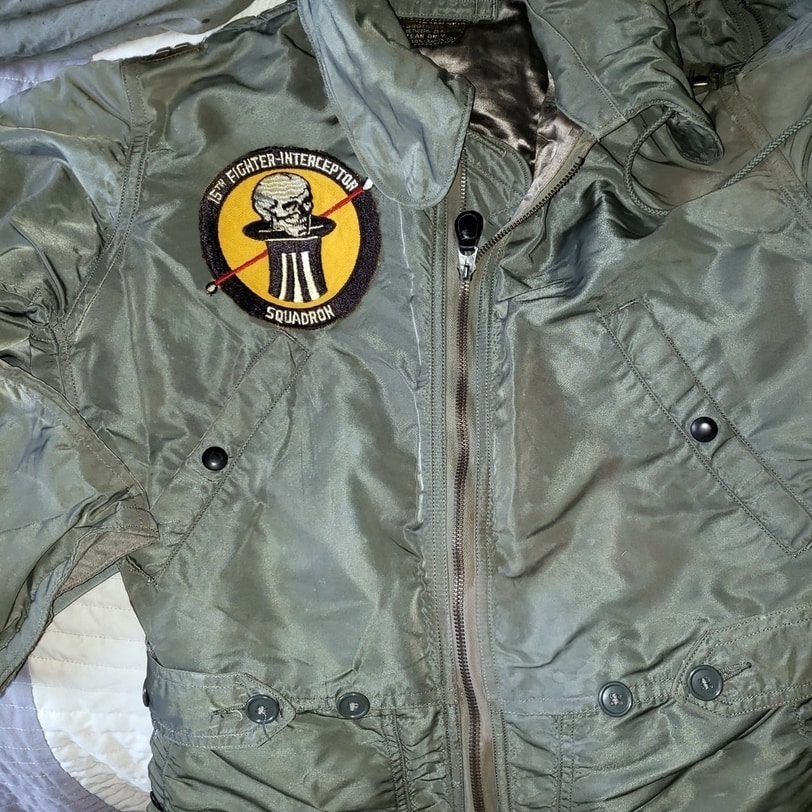 I have often wondered why a patch from the 15th Fighter Interceptor Squadron, Davis-Monthan AFB, Arizona, (a land of cacti, scorpions, and gila monsters) is sewn to a winter-weight flightsuit. Yes, the pilots of Air Defense Command had to be ready for anything, but issuing arctic equipment at a base in the blazing desert seems a bit extreme. I know, I know; they do have winter there, but still...