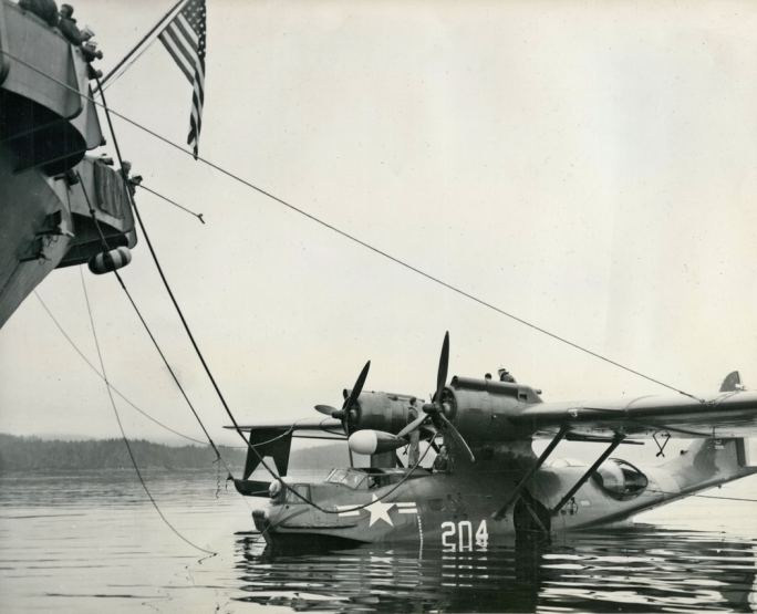 A PBY-5A (33979) of NAS Seattle refuels from the seaplane tender USS Pine Island in Alaskan waters, July, 1949.