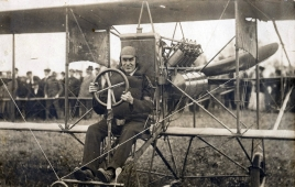 An early aviator whose name escapes me at the controls of a Curtiss D.
