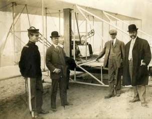 Captain Halstead Dorey, the Hon. James Beck, Wilbur Wright, and William Hammer at the Fulton-Hudson Celebration in 1909. Taking off from Governors Island, Wright flew his aircraft on a 33 minute flight up and down the Hudson River. A canoe was attached to the underside of the craft in case Wilbur found himself in the Hudson.