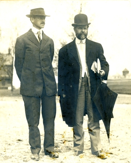 """Curtiss and William Hammer discuss the goings on during the celebration. A """"fly-off"""" between Curtiss and Wright was much anticipated, but Curtiss's endeavors were lackluster and it was Wright who stole the show with flights up and down the Hudson, around the Statue of Liberty, etc."""