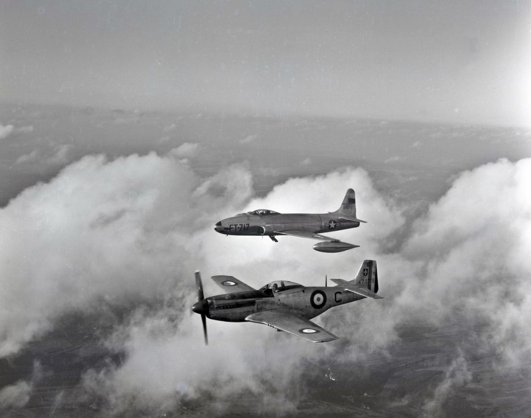 """This is the same F-80 as seen in the first photo, but in the spirit of NATO cooperation, it flies with a Mustang of the French Air Force's Groupe de Reconnaissance GR II/33 """"Savoie""""."""