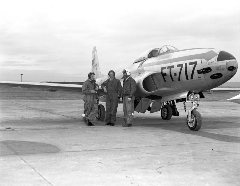 RAF pilots and their USAF counterpart exchanging pleasantries alongside an F-80 (54-8717) of the 36th Fighter Bomber Group. This aircraft crashed in 1952.